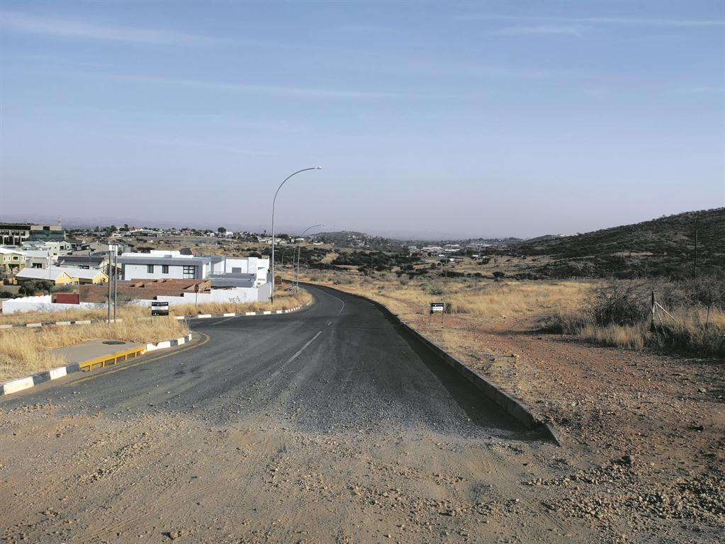 The dirty side of building sites environment namibian sun for Images of building sites